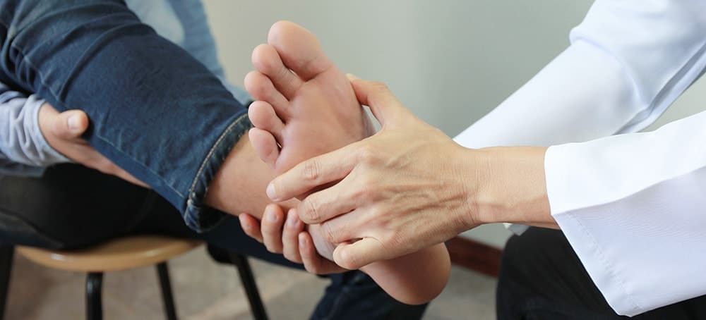 foot doctor treating athlete